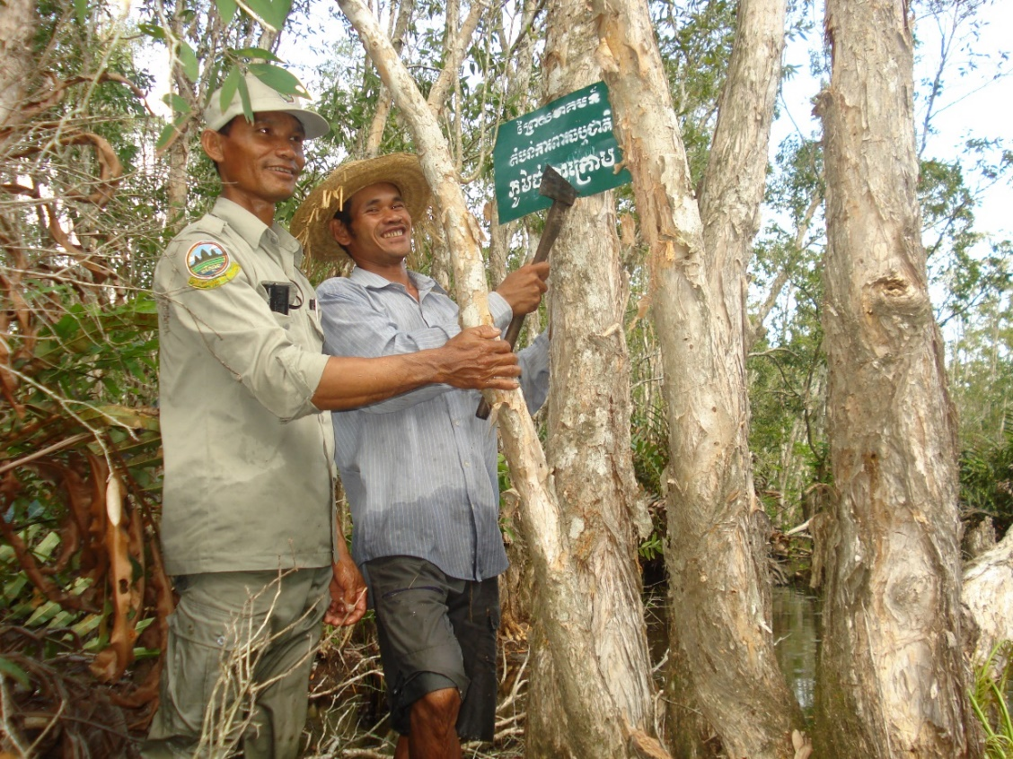 Community members and environment officials work together to protect the forest